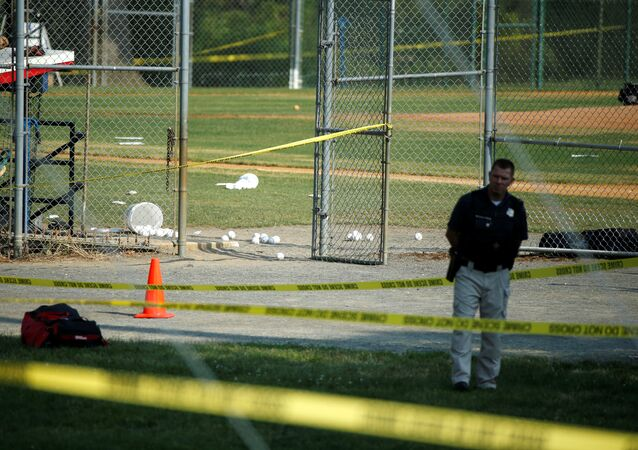A police officer mans a shooting scene after a gunman opened fire on Republican members of Congress during a baseball practice near Washington in Alexandria, Virginia, June 14, 2017