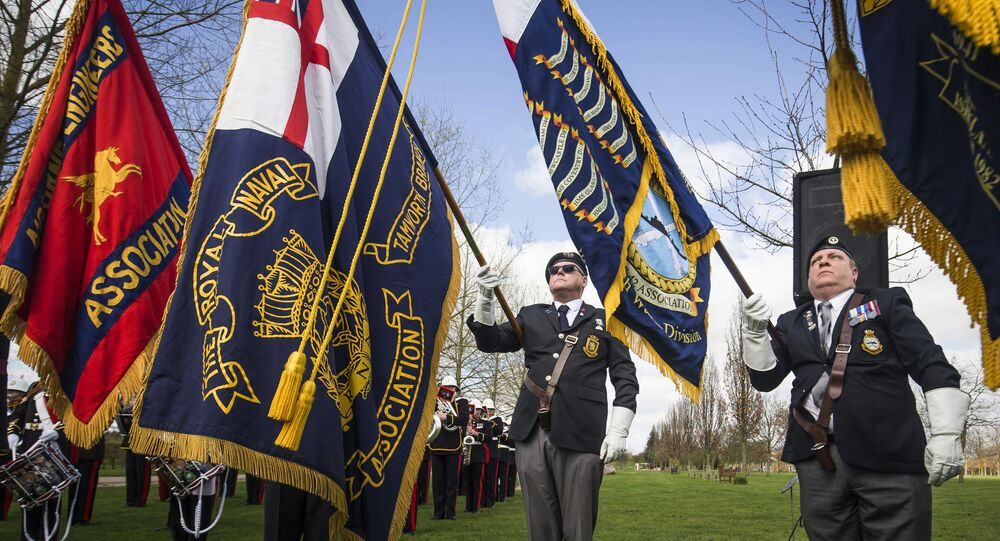 Military colours are displayed during a service marking the 35th anniversary of the Argentine invasion of the Falklands, at the National Memorial Arboretum in Staffordshire, England, Sunday April 2, 2017.