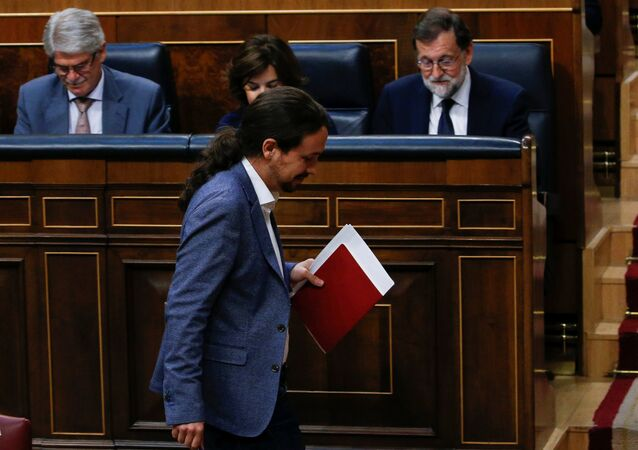 Podemos leader Pablo Iglesias passes in front of Prime Minister Mariano Rajoy during a motion of no confidence debate in parliament in Madrid, Spain, June 13, 2017