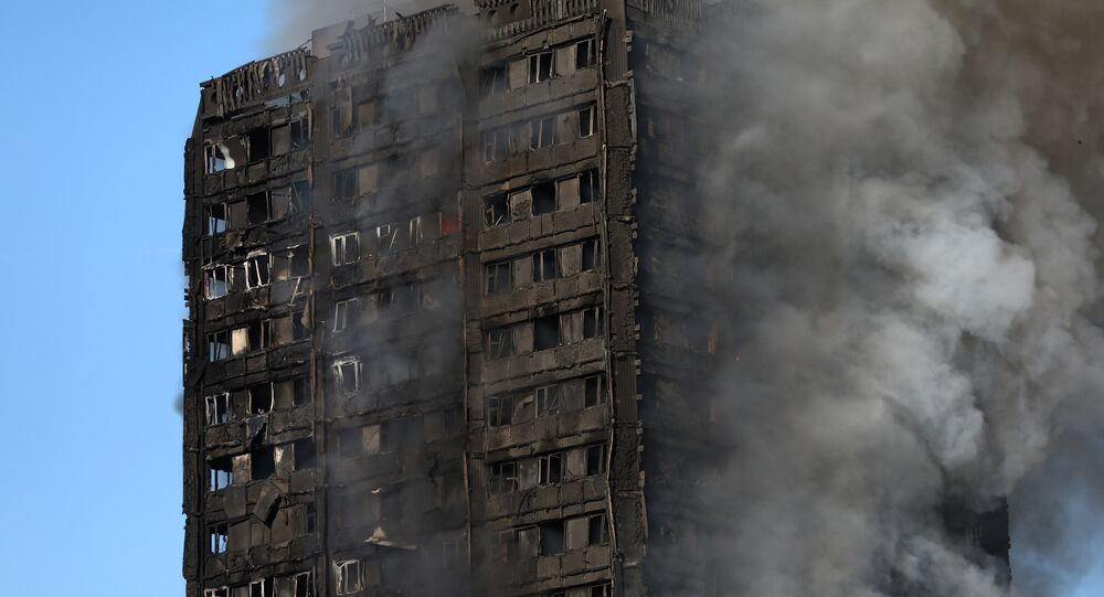 Smoke billows as firefighters tackle a serious fire in a tower block at Latimer Road in West London, Britain June 14, 2017.