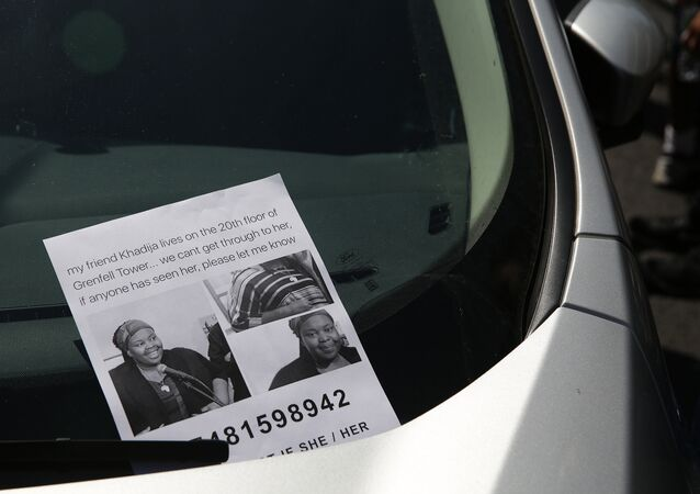 A flyer for a missing person Khadija Saye, is seen on a car near a temporary casualty bureau opened for people affected by the fire at Grenfell Tower, a residential block of flats on June 14, 2017 in west London, as firefighters continue to control a fire.