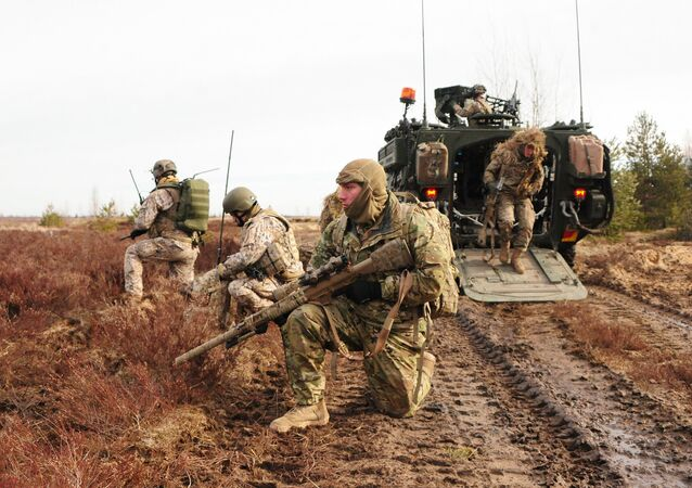 U.S. Army snipers assigned to Headquarters and Headquarters Troop, 2nd Cavalry Regiment, and Latvian land forces snipers, pull perimeter security during a combined live-fire exercise with the Latvian land forces, part of Operation Atlantic Resolve in Adazi training area, Latvia, March 6, 2015