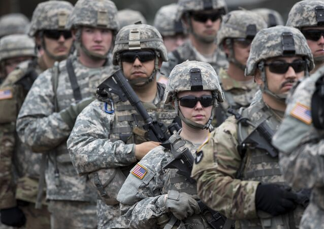 U.S. soldiers attend an opening ceremony of military exercise 'Iron Wolf 2017', at the training range in Pabrade, north of the capital Vilnius, Lithuania on Monday, June 12, 2017