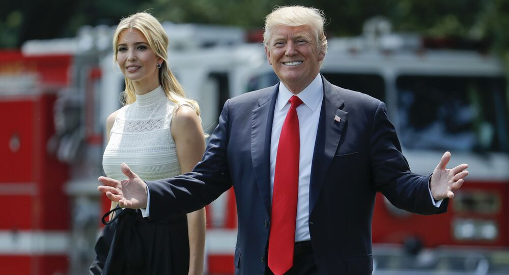 President Donald Trump gestures as he walks with his daughter Ivanka Trump across the South Lawn of the White House in Washingto