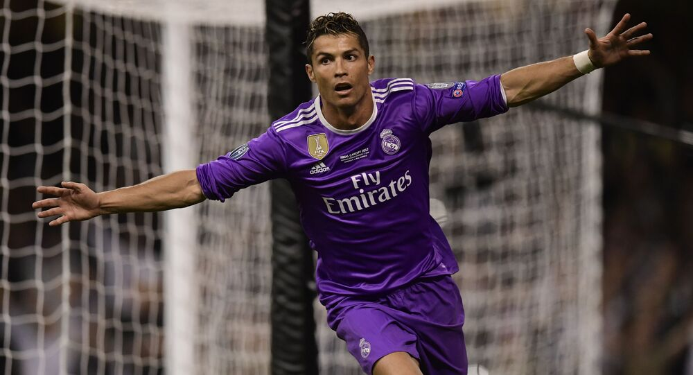 Real Madrid's Portuguese striker Cristiano Ronaldo celebrates after scoring their third goal during the UEFA Champions League final football match between Juventus and Real Madrid at The Principality Stadium in Cardiff, south Wales
