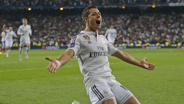 Real Madrid's Chicharito celebrates scoring his side's first goal during the second leg quarterfinal Champions League soccer match between Real Madrid and Atletico Madrid at Santiago Bernabeu stadium in Madrid, Spain - Sputnik International
