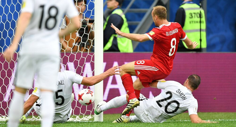 From left: Russia's Denis Glushakov scores a goal during the 2017 FIFA Confederations Cup match between Russia and New Zealand. Right: New Zealand's Tommy Smith
