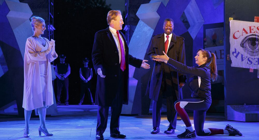 In this May 21, 2017 photo provided by The Public Theater, Tina Benko, left, portrays Melania Trump in the role of Caesar's wife, Calpurnia, and Gregg Henry, center left, portrays President Donald Trump in the role of Julius Caesar during a dress rehearsal of The Public Theater's Free Shakespeare in the Park production of Julius Caesar, in New York. Rounding out the cast on stage is Teagle F. Bougere as Casca, and Elizabeth Marvel, right, as Marc Anthony.