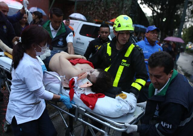 A woman is evacuated on a gurney after an explosion at the Centro Andino shopping center in Bogota, Colombia, Saturday, June 17, 2017.