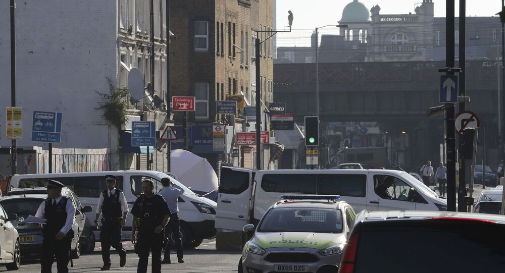 A forensic tent and police are seen on Seven Sisters Road looking to Finsbury Park Mosque after a vehicle struck pedestrians in north London