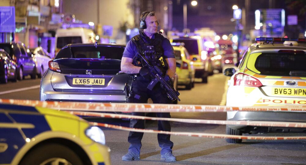 An armed police officer mans a cordon on the Seven Sisters Road at Finsbury Park where a vehicle struck pedestrians in London Monday, June 19, 2017. Police say a vehicle struck pedestrians on a road in north London, leaving several casualties and one person has been arrested.