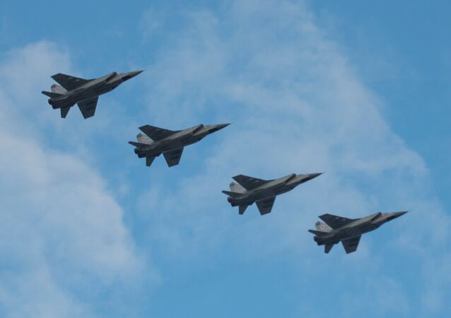 Mikoyan MIG-31 interceptor jets in air over St.Petersburg's Palace Square during an air display rehearsal for the May 9 Victory Parade