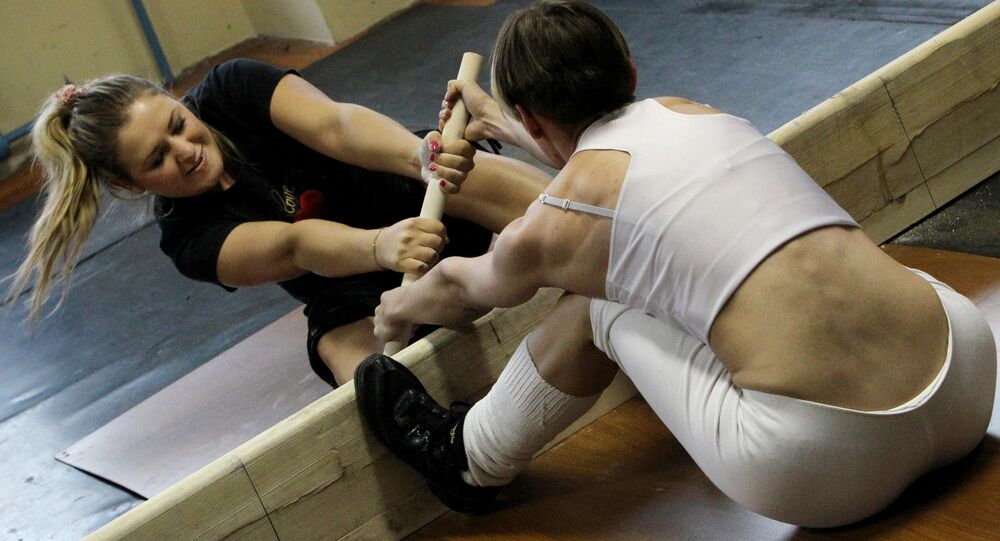 Participants compete at a New Year women's mas-wrestling tournament. (File)