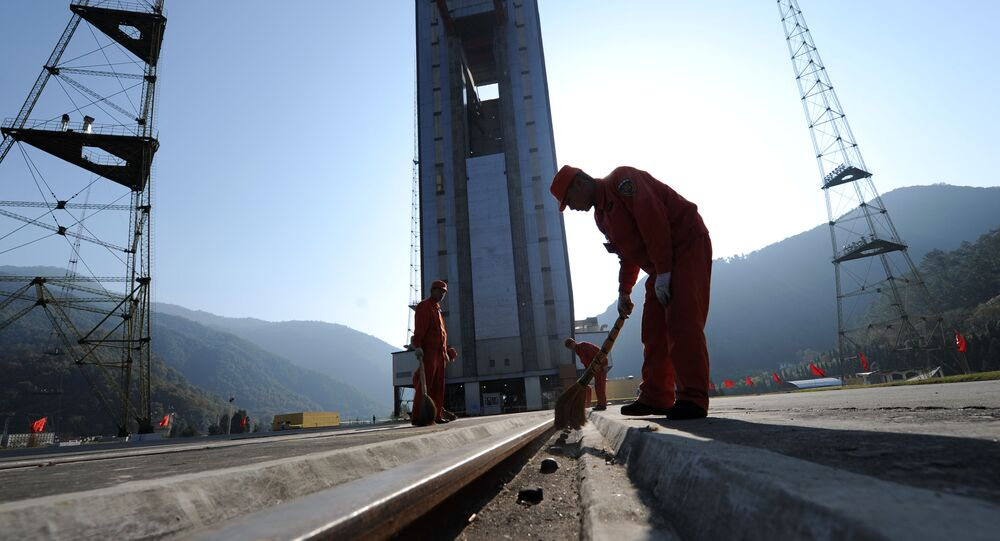 Chinese workers make final preparations to the launch pad at the Xichang Satellite Launch Centre in the southwestern province of Sichuan. (File)