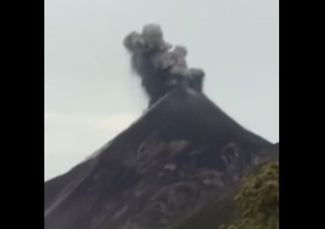 Volcano erupts and gets struck by lightning