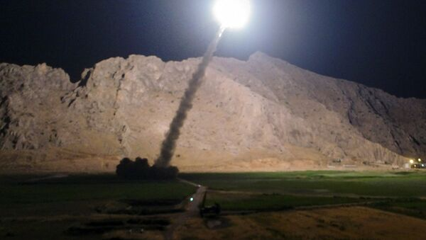 In this picture released by the Iranian state-run IRIB News Agency on Monday, June 19, 2017, a missile is fired from city of Kermanshah in western Iran targeting the Islamic State group in Syria - Sputnik International