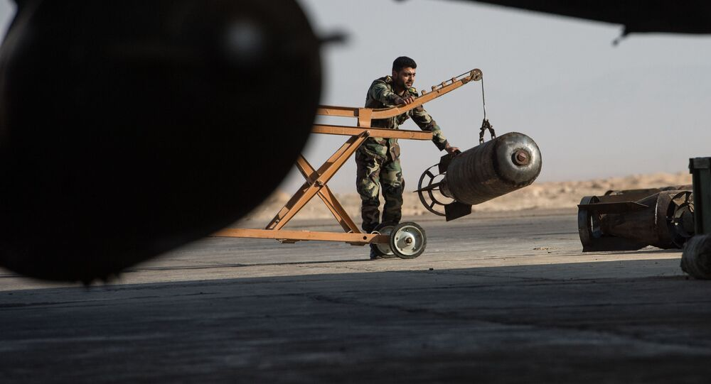 A Syrian army soldier prepares the Su-22 fighter jet for a flight at the Syrian Air Force base in Homs province. File photo