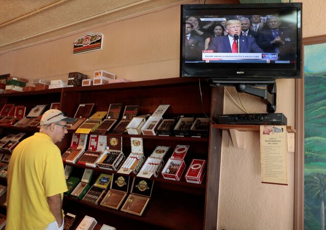 A tourist buys Cuban cigars at the San Roman cigar store in the Little Havana district as U.S. President Donald Trump announces changes to U.S.-Cuba policy, in Miami, Florida, U.S. June 16, 2017
