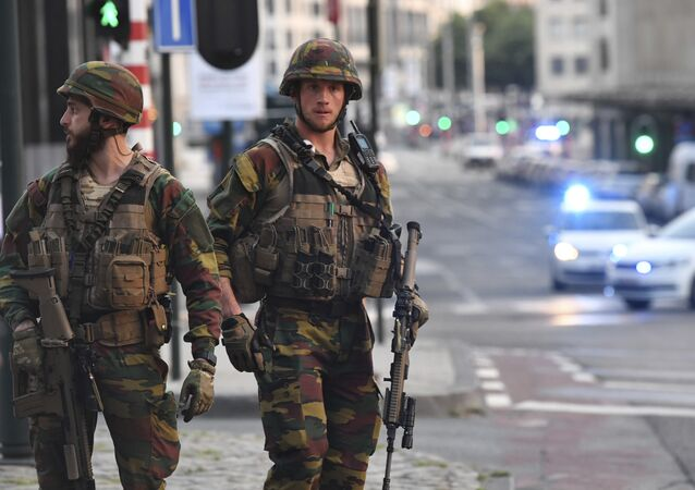 In this image taken from video, police cars create a cordon near the train station in central Brussels, Tuesday June 20, 2017. Belgian media report that explosion-like noises have been heard at a Brussels train station; the main square evacuated.