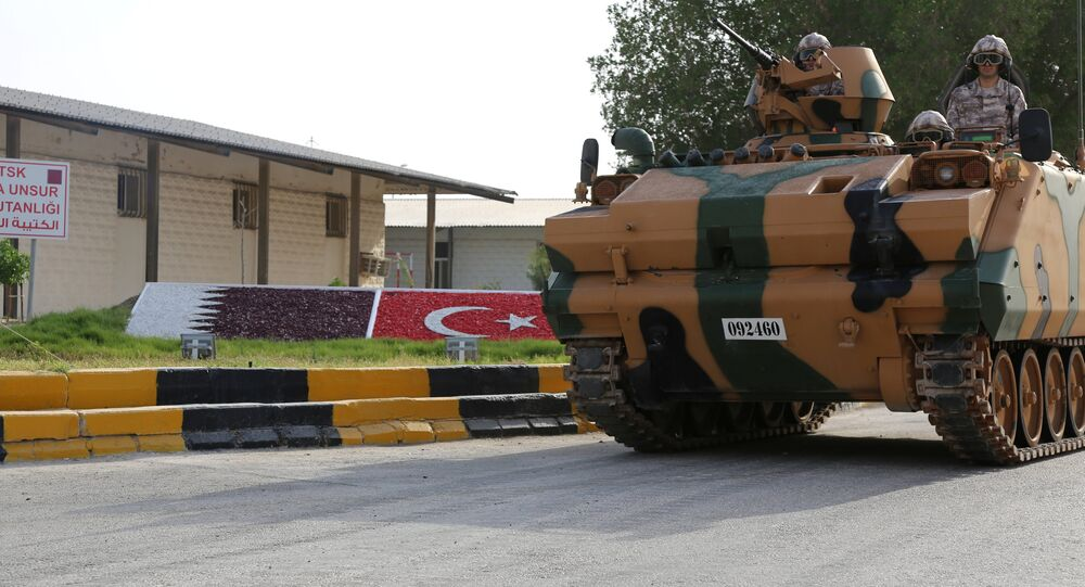 A Turkish APC drives at their military base in Doha, Qatar, June 18, 2017