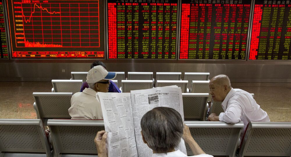Investors wait for the start of the afternoon trading at a brokerage in Beijing, China, Wednesday, June 21, 2017