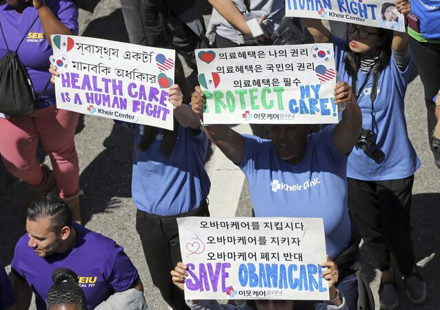 Hundreds of people march through downtown Los Angeles protesting President Donald Trump's plan to dismantle the Affordable Care Act, his predecessor's signature health care law, Thursday, March 23, 2017