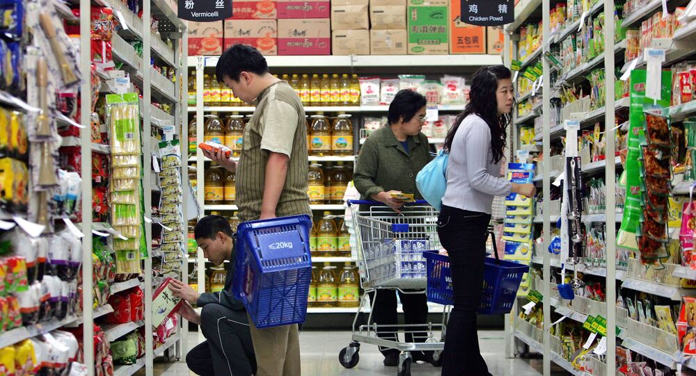 Chinese customers shop at one of the Chinese outlets of the U.S.-based Wal-Mart stores in Beijing, China Thursday Oct. 12, 2006