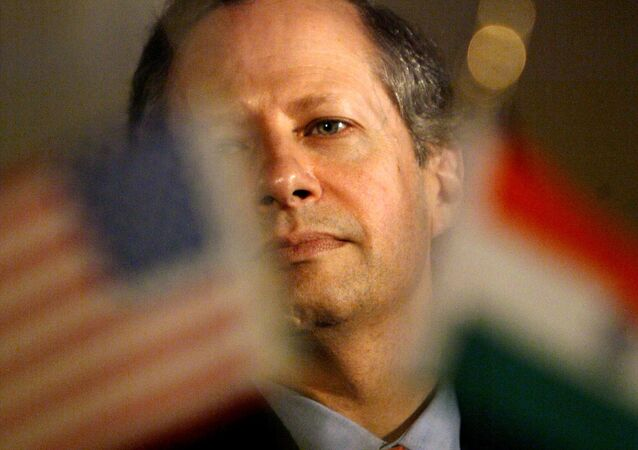(File) U.S. Undersecretary of Commerce Kenneth Juster listens to a speaker at the India U.S. Information Security Summit in New Delhi, India, Tuesday, Oct. 12, 2004