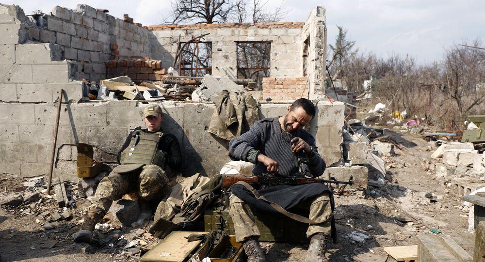An Ukrainian serviceman prepares ammunition in Avdiivka, Donetsk region on March 30, 2017