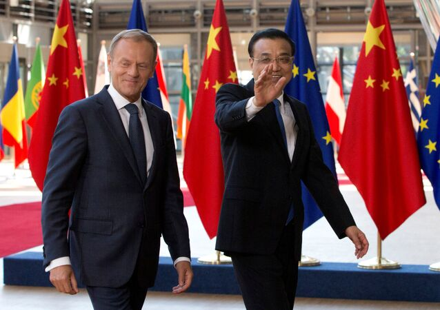 European Council President Donald Tusk and Chinese Premier Li Keqiang (R) arrive to attend a EU-China Summit in Brussels, Belgium June 2, 2017