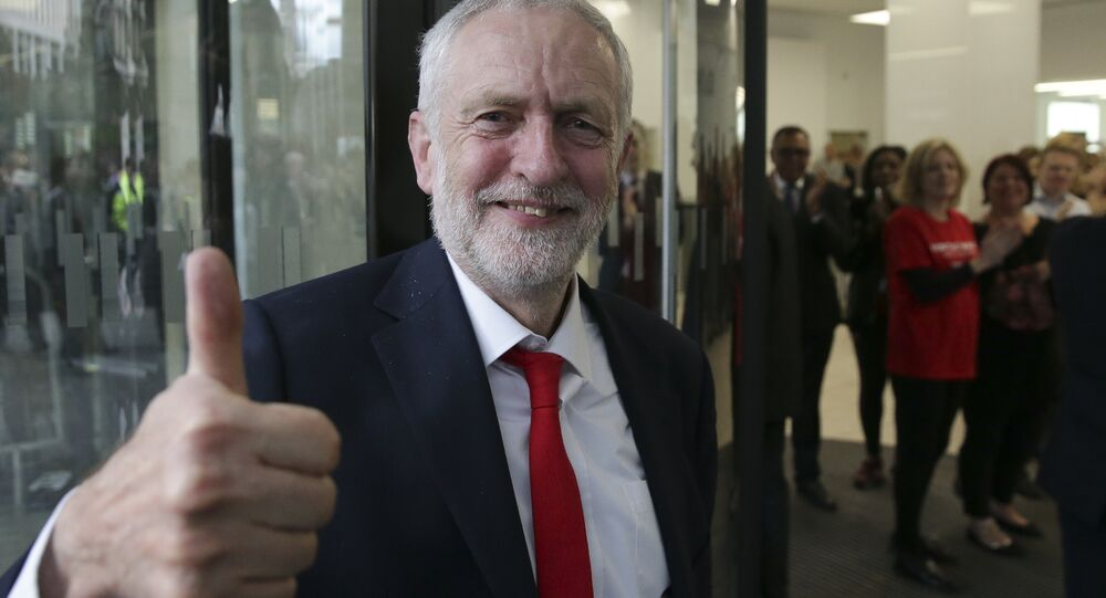 Britain's opposition Labour party Leader Jeremy Corbyn gives a thumbs up as he arrives at Labour Party headquarters in central London on June 9, 2017.