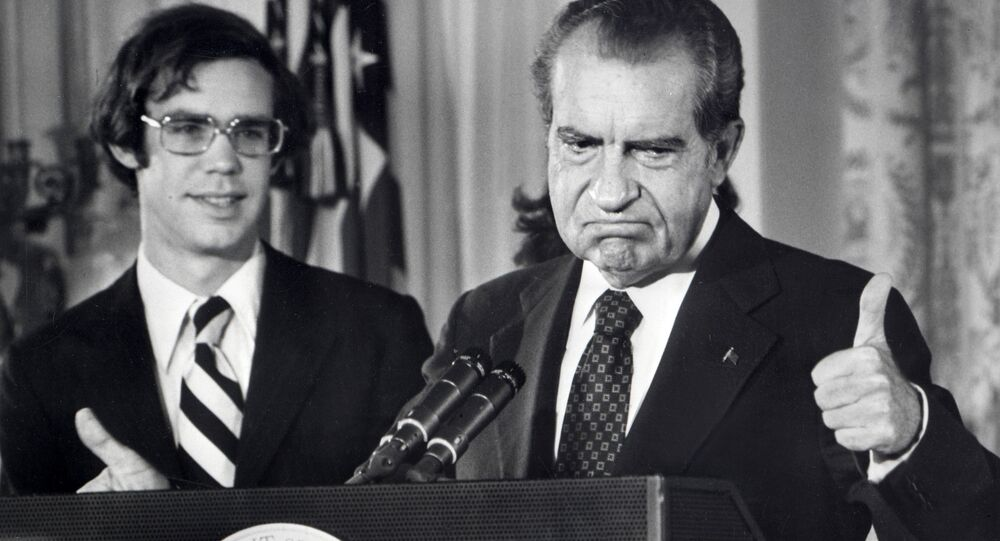 File photo dated 09 August 1974 of the 37th President of the United States, Richard Nixon, as he bids farewell to the White House staff.