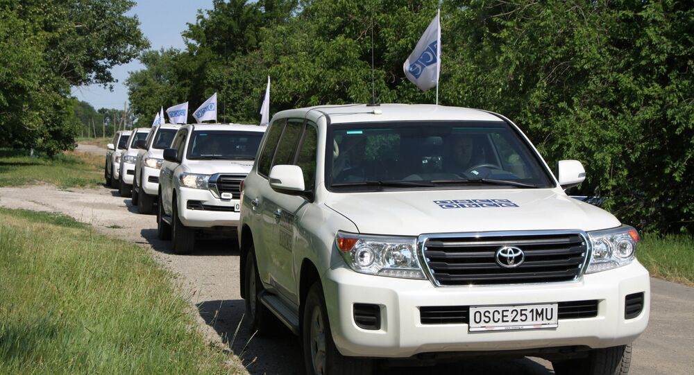 A convoy of OSCE Special Monitoring Mission (SMM) vehicles during an inspection of the frontline township of Sakhanka in the self-proclaimed Donetsk People's Republic.