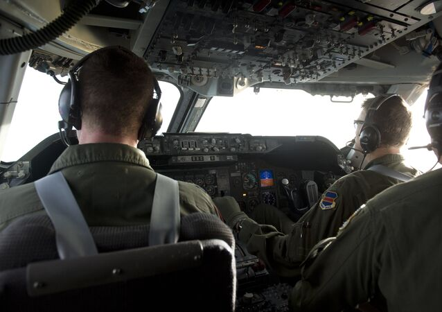 The flight crew of a Boeing E4-B airplane carrying US Secretary of Defense Leon Panetta flies the aircraft as seen from the cockpit in flight over Alaska on November 16, 2012, en route to San Francisco, California.