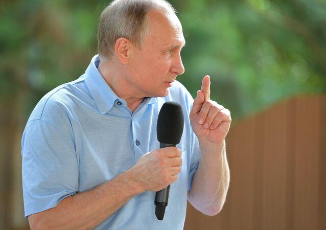 Russian President Vladimir Putin talks to children attending the Samantha's Smile seventh shift at the Artek international children's center in Crimea