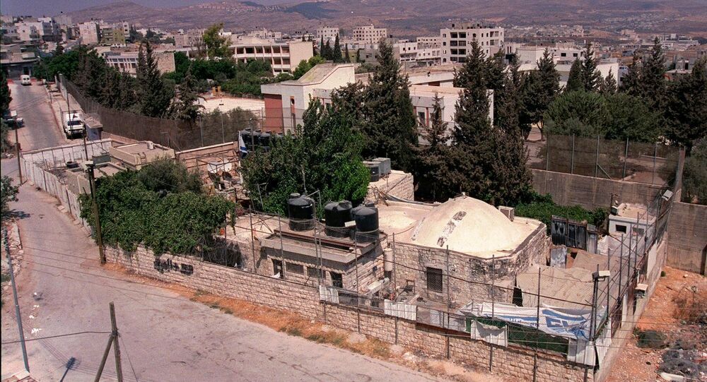 Joseph's Tomb compound is seen from a building in the West Bank city of Nablus. (File)