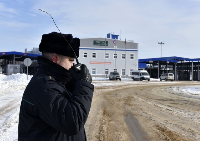 A boreder guard is seen here at the Novye Yurkovichi multi-lane automobile border crossing checkpoint in the Bryansk Region.