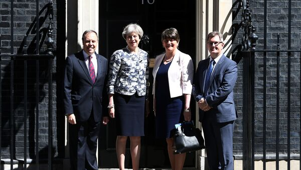 Britain's Prime Minister, Theresa May, poses for a photograph with Democratic Unionist Party (DUP) Leader Arlene Foster, Deputy Leader Nigel Dodds, and Chief Whip Jeffrey Donaldson, outside 10 Downing Street, in central London, Britain June 26, 2017. - Sputnik International