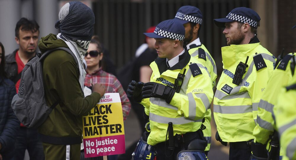 Campaigners face-off with police as they protest over the death of 25-year old young father Edir Frederico Da Costa, who died on June 21 six days after he was detained by police, in London Sunday June 25, 2017.