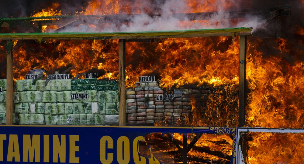 Smoke and flames billow from burning drugs during a destruction ceremony of seized narcotic drugs on the outskirts of Yangon, Myanmar, Monday, June 26, 2017.
