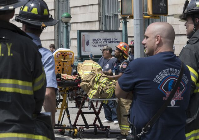 Emergency service personnel work at the scene of a subway train derailment, Tuesday, June 27, 2017, in the Harlem neighborhood of New York