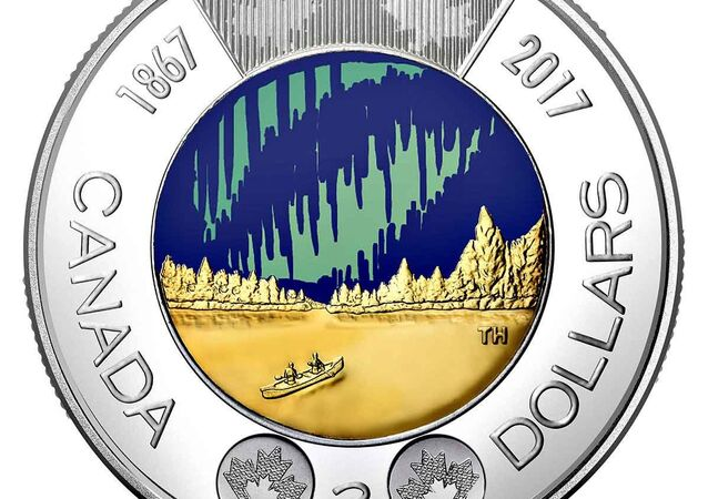 A glow-in-the-dark coin depicting the Aurora Borealis, minted by the Royal Canadian Mint to celebrate the nation's 150th anniversary