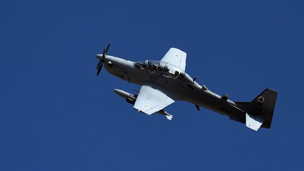 In this photograph taken on October 18, 2016, an Afghan Air Force Embraer A-29 Super Tucano aircraft flies during an airstrike training mission on the outskirts of Logar province - Sputnik International