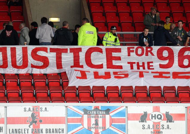 Liverpool fans place a banner about the Hillsborough justice campaign ahead of the English Premier League soccer match between Sunderland and Liverpool at the Stadium of Light, Sunderland, England, Saturday, Sept. 15, 2012.
