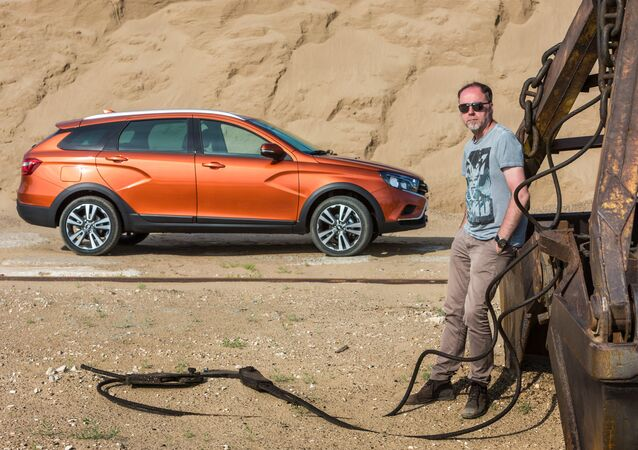 Lada Design department director Steve Mattin and the new Lada Vesta SW Cross wagon by AvtoVAZ