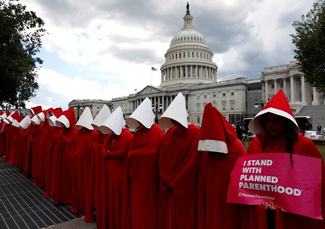 Women dressed as handmaids from the novel, film and television series The Handmaid's Tale demonstrate against cuts for Planned Parenthood in the Republican Senate healthcare bill at the U.S. Capitol in Washington, U.S., June 27, 2017