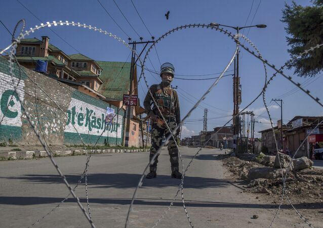An Indian paramilitary soldier stands guard during a curfew in Srinagar, Indian controlled Kashmir.