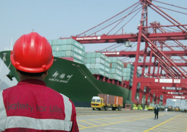 A worker watches operations at the container off-loading terminal in the Jawaharlal Nehru Port Trust (JNPT) premises in Mumbai (File)