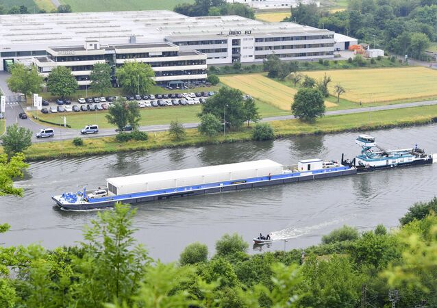 The push boat 'Edda' pushes the transport ship loaded with three Castor containers with nuclear waste on the Neckar river in Obrigheim, Germany, Wednesday, June 28, 2017. The containers will be transported to the interim storage in Neckarwestheim. It is the first nuclear waste transport across a river containing highly radioactive waste.