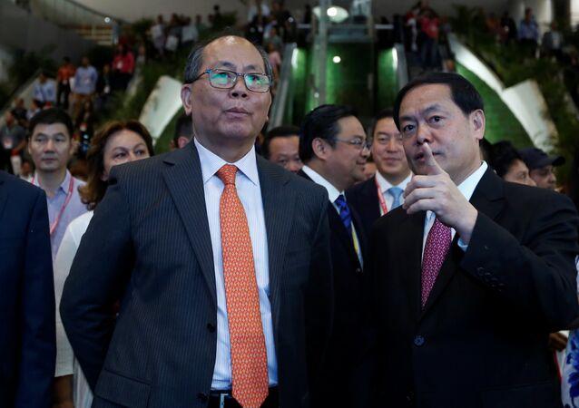 China's Ambassador to Mexico Qiu Xiaoqi listens to Mi Jiao Meng, Mayor of Huizhou City, during the Expo China Homelife Show, a platform for leading Chinese companies seeking to do business in Mexico, in Mexico City, Mexico June 13, 2017